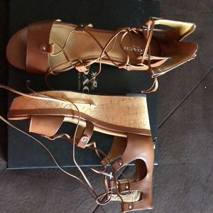 Brand new Coach lace up wedges. Never been worn